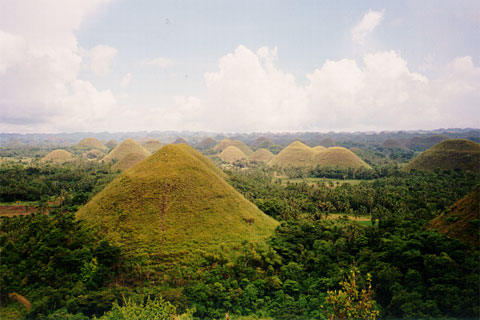 The Chocolate Hills just after the summer, when they have their characteristic brown color.