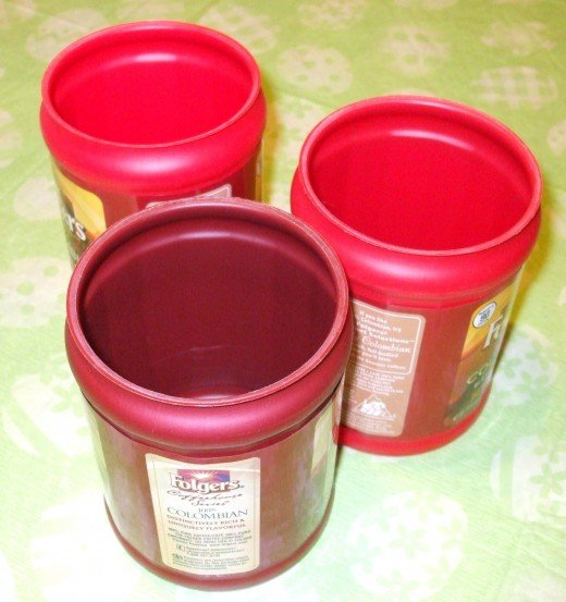 "Three plastic coffee ""cans."""