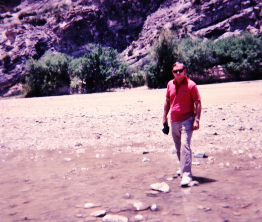 My husband walking on some rocks in the Rio Grande River.