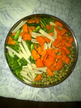 Carrots, green bell pepper, potato and green peas