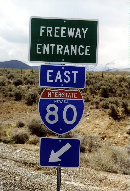 Sign for I-80 in Nevada that features the name of the state on the sign
