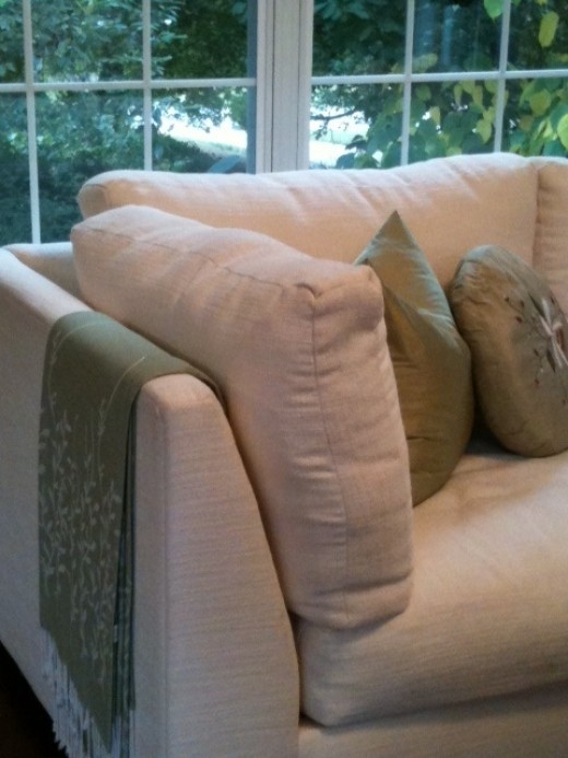 Eliminate window dressing, add a throw and pillows to comfortable sofa for change