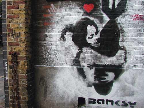 Girl hugging bomb by Bansky