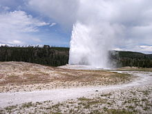 Old Faithful Geyser erupting at Yellowstone National Park