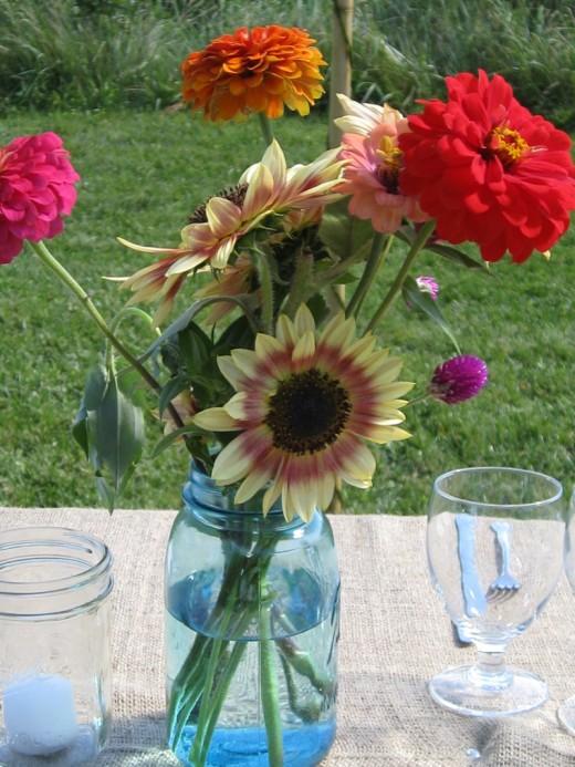 Mason jars make great candle holders for wedding decor