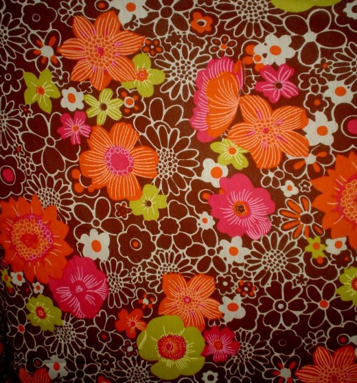 This is a great piece of vintage fabric. It's not a great background for your photos
