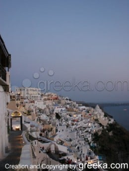Photos of Santorini: View of the village of Fira, the main town of Santorini, by night.