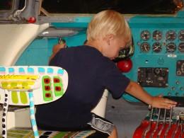 Alex pretending to be a pilot.