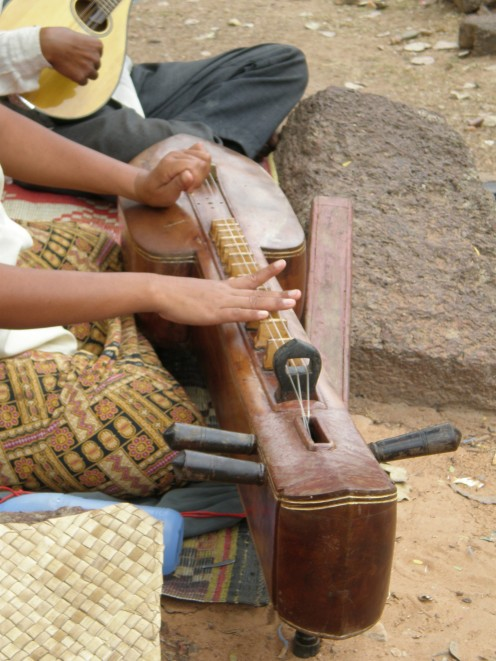 Interesting street musicians, Temple of Bakong, Angkor, Cambodia