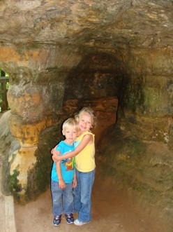 Grace and Alex in a little mini cave at the falls.