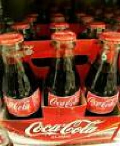 COCA COLA IN SIX-PACK CONTAINER. FAMILIES BOUGHT THESE LIKE HOT CAKES UPON THEIR INTRODUCTION.