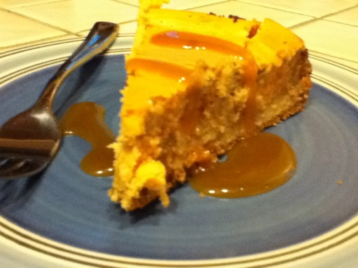 Coffee Caramel Swirl Cheesecake with a caramel sauce topping.