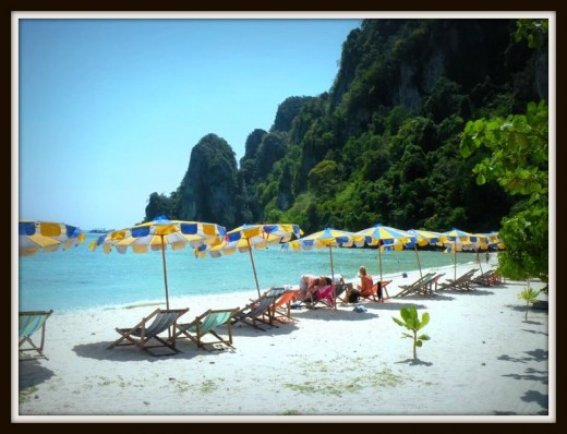 Tourists sunbathe at Long Beach in Phi Phi Don.