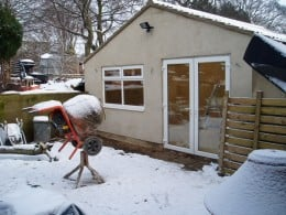 snow stopped work for over a month. Cement and concrete don't like below zero temperatures
