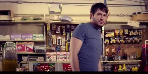 Adam peruses the shelves of a convenient store and locks eyes with a beautiful girl.  Or does he?