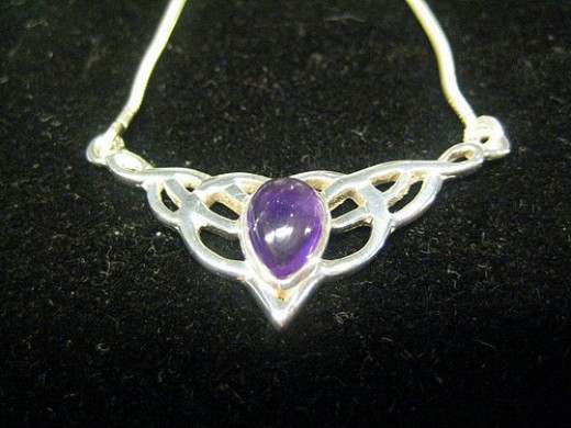 Celtic jewelry with semi-precious stones are popular gift items. Photo ...