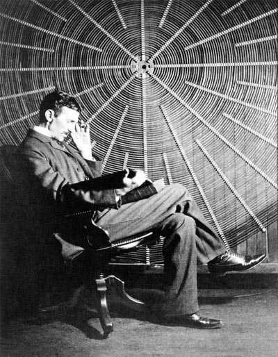 Young Tesla is seated in front of his spiral transformer. He is single handed in his responsibility for the major electrical technological advances of the 20th century.