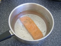 Enough cold water is added to comfortably cover the salmon fillet