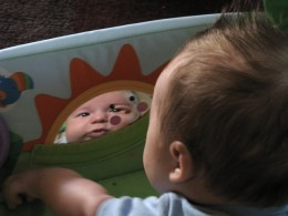 My son gazing at his reflection during tummy time