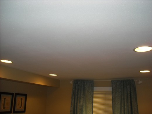 Recessed lighting located in a basement bedroom.