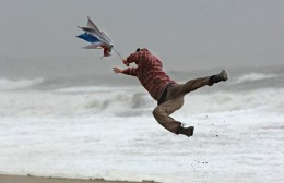 Winds knock a walker of his feet
