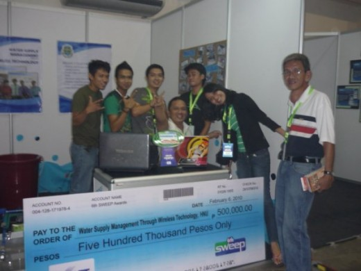 The Proponent team with their 1st prize check