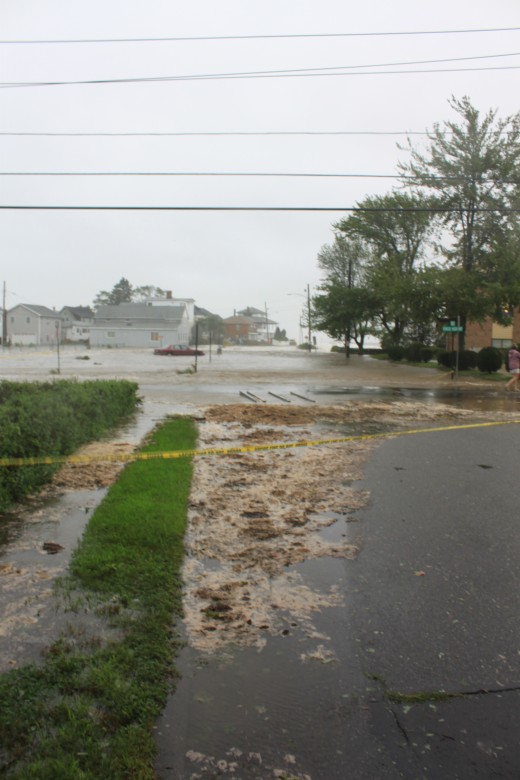 flooded anchor beach in Milford CT, car flooded in parking lot, beach is way down the street, notice debris.
