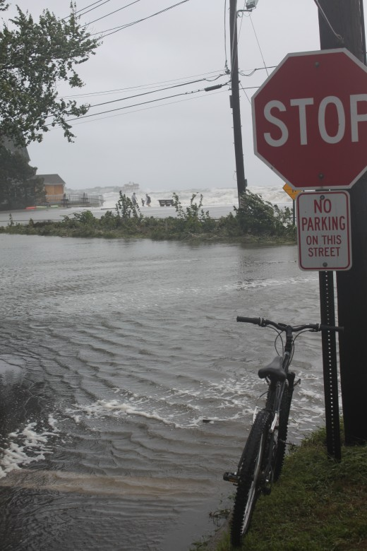 stop sign and bike by a flooded melba street in Milford, Ct along Long Island Sound. Storm surge from Hurricane Irene