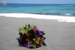 My wedding bouquet, lying on the white sand at The Reef Resort