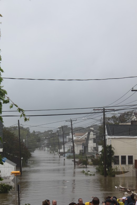 The view of the street (Bayshore Drive and Melba street) behind the houses in the above pictures being slammed by waves from Hurricane Irene in Milfor, CT on Aug 28, 2011