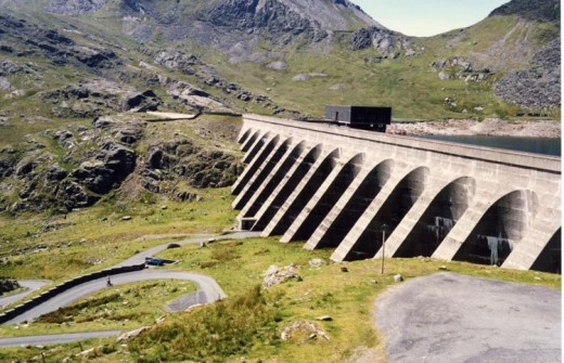 Stwlan dam, Wales.  This installation pumps water uphill, behind the dam, to store energy.  It's the most efficient method available today, but one limited to suitable locations.  Image courtesy Adrian Pingstone and Wikimeda Commons.