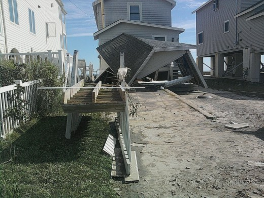 I took this photo with my cell phone of the destruction along the beach to people's homes in MIlford, Ct from hurricane Irene, the waves crashed right through bottom floors!