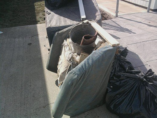 a pile of furniture put out on the street after the storm, but you would be surprised to hear where it came from!