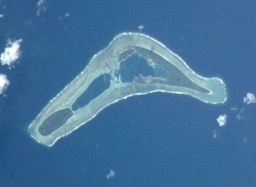 Nanumea Island in Tuvalu.  Even from above, the low elevation above sea level can be discerned.  Like the rest of Tuvalu, Nanumea is at risk due to rising sea levels.  Image courtesy NASA.