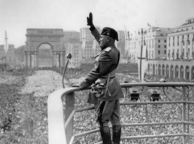 Benito Mussolini doing a Roman Salute