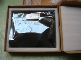 New motherboard in anti-static shielding bag.