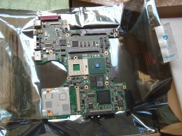 Motherboard without the battery holder indicating that it has not been used before.