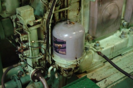 A lube oil centrifugal filter on a trunk engine.