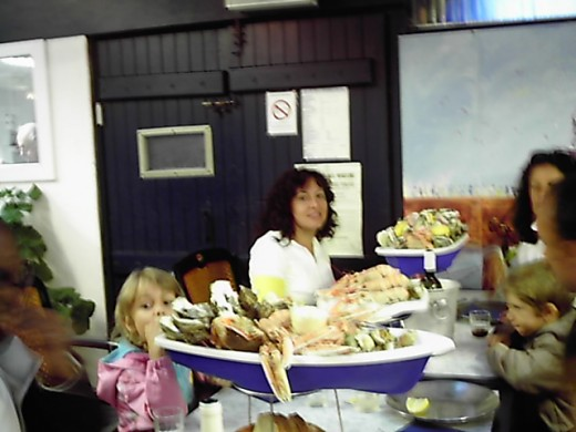 With boats of freshly caught seafood at the table in a French restaurant specialized in plain seafood, either raw like oysters or just steamed. Delicious !!!!