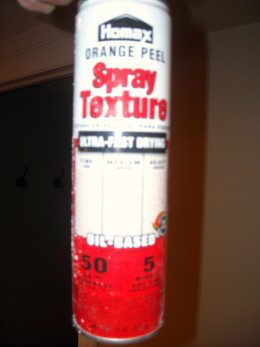 Aerosol can of drywall texture for small patch areas.