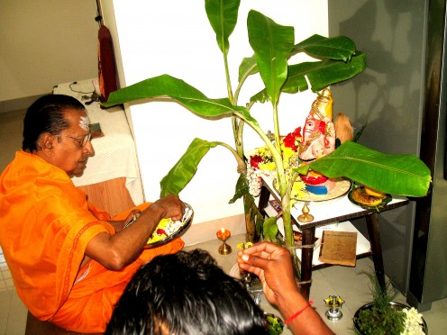 As the Pandit Chants the Mantra's he guides the worshiper what to do.Like dip flower in holy water and sprinkle on the idol,place flower etc,etc till pooja is completed.