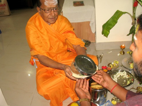 When the Pooja is completed the Pundit receives the Upaindana or Gift from the worshipers which is covered and presented.There is no fee for the pooja conducted by the Pandit.