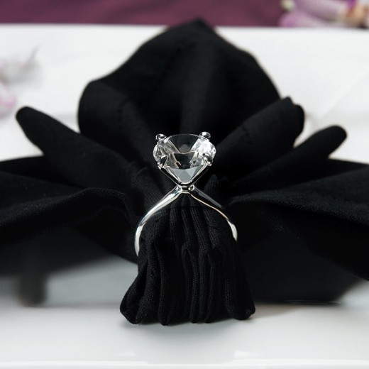 Silver plated diamond napkin holders show the reverence and care with which a napkin should be treated.