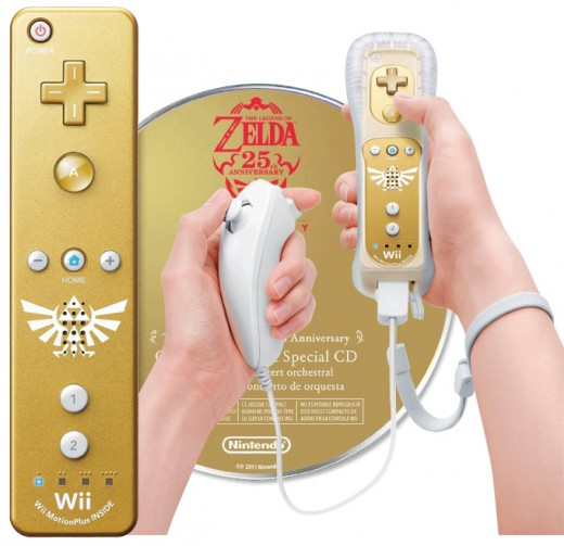 The gold Wii Remote with Triforce Symbol Accessory and the free music cd that are bundled with the Skyward Sword purchase.