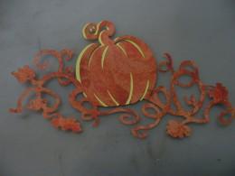Yellow pumpkin adhered behind Orange