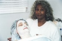 Thelma performing a facial which is one of her specialties