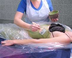 First the herbal mixture, then the saran wrap.  We were wrapped up like sausages.
