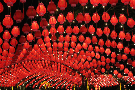 Hundreds of bright red lanterns lit the night sky