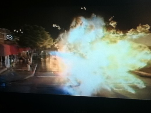Pam steps in to save her maker and ends up blowing up the street instead.