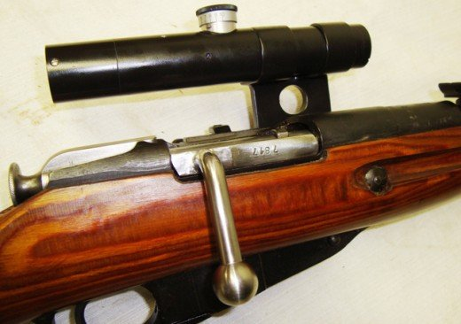 A bent bolt and an original scope and mount shown above.